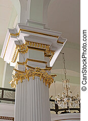 Gold Leaf - A column in a church freshly painted with gold...