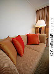 Sofa Set - A sofa with cushion in a room setting
