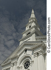 New England Church Spire Against Blue Sky