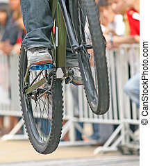 Mountain Bike Jump - Close up of a mountain bike competitor...