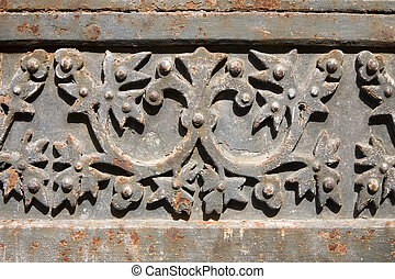 Metal gate - Detail of a decorated rusty metal gate