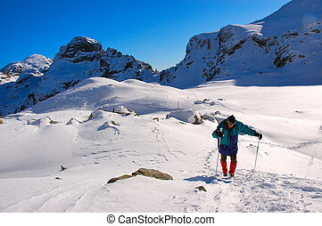 man hiking in the high mountains
