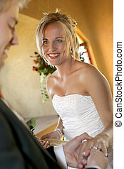 I do - A Young bride having her weddingring put on