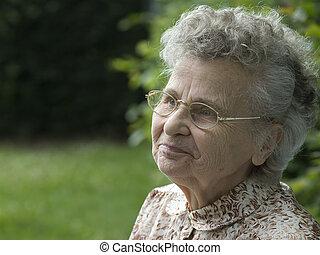elderly woman  - portrait of the elderly woman outdoors