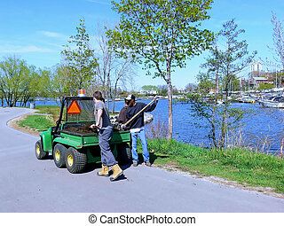 Park worker 60934 - Three park worker in the spring putting...