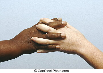 Clasping hands - putting hands together in agreement as...