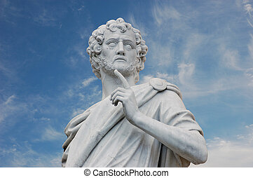 Roman Statue - Ancient roman statue against blue sky