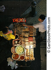 Street food vendor - A top view of a sidewalk food stand in...
