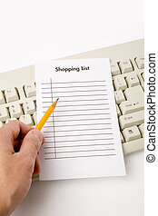 online shopping - computer keyboard and shopping list,...