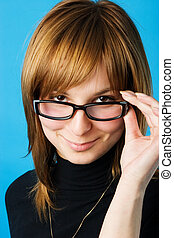 young woman in glasses - Close-up portrait of young woman...