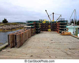 lobster traps and boat - lobster traps and lobster boat in...