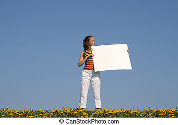 Girl holding blank banner with copy space