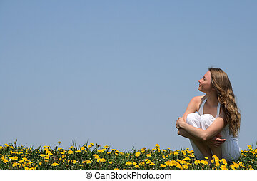 Woman enjoying sunshine - Young woman enjoying sunshine in a...