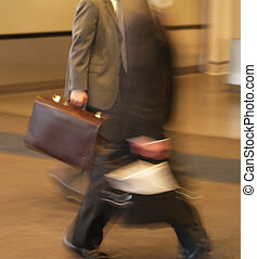 businessmen in a hurry - business men walking in a hurry to...