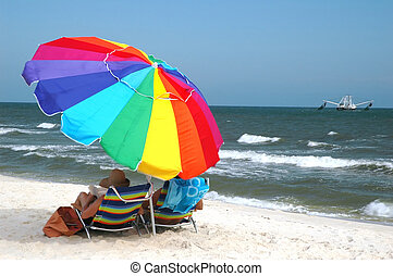 Beach scene with beach chairs and umbrella with shrimp boat...