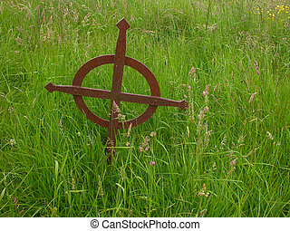 Irish Gravemarker - A rusty celtic cross, marking a grave in...