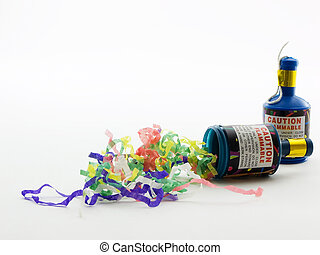 Party Poppers - Two party poppers with confetti on a white...