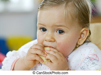Baby eating apple - Small baby is eating apple
