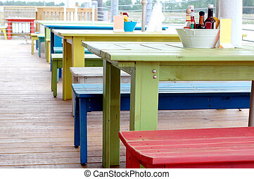 Restaurant Tables - Colorful restaurant tables outside on...