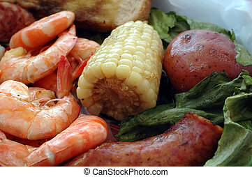 Shrimp Boil - Shrimp boil with corn on the cob, sausage,...