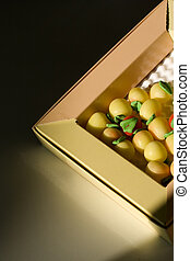 Apple Candys - a box of apple candys with a black background