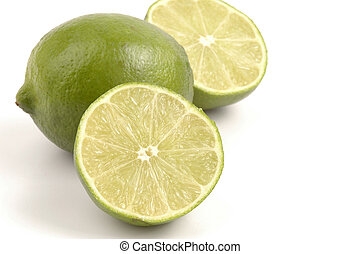 Limes - Fresh green limes isolated on a white background.