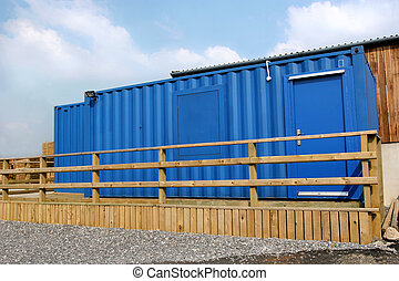 Storage Container - Blue container used as an office with a...