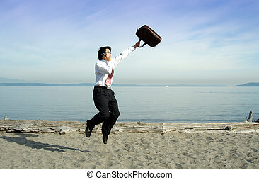 Happy businessman - A businessman jumping and talking on the...