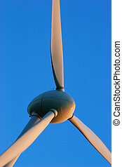 Environment friendly energy - Windturbines close-up on blue...