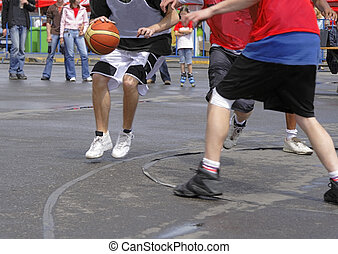 Streetball match - Action detail image of a streetball match...