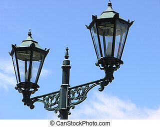Lamplight - Two Decorative Lanterns against a sky background