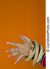 Captive Woman 2 - Woman hands tiedup with a strong rope