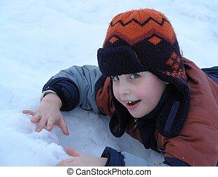 boy lies on snow