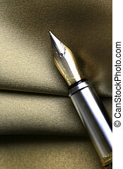 Fountain Pen - An abstract of Fountain pen on a golden cloth...