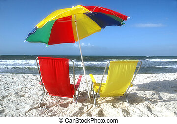 Beach scene with beach chairs and unbrella.
