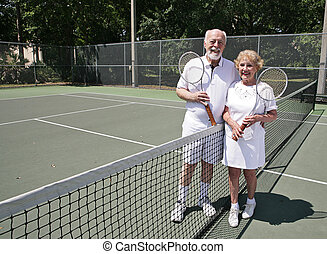Senior Tennis with Copyspace - A happy active senior couple...