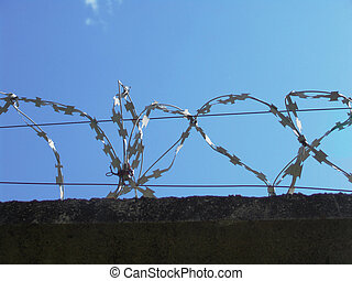 Barbed wire 2 - Razor wire above a wall