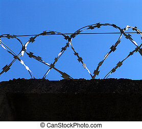 Barbed wire 3 - Razor wire above a wall