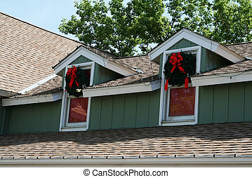 Christmas windows - Two windows on a house decorated with...