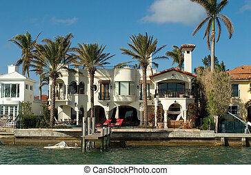 Mansion with chairs and palms - Expensive water front houses...