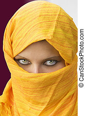 burka - attactive and strong eyes behind an orange scarf...