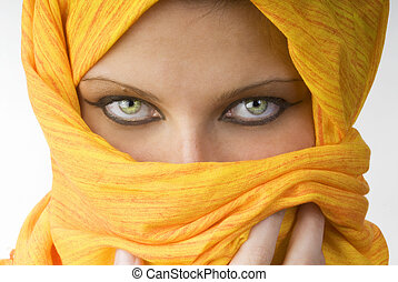 strong eyes - attactive and strong eyes behind an orange...
