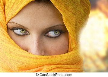 the look - attactive and strong eyes behind an orange scarf...