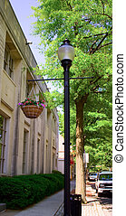 Light Post - Light post on a city street with a hanging...