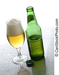 beer - cold beer in glass with bottle beside