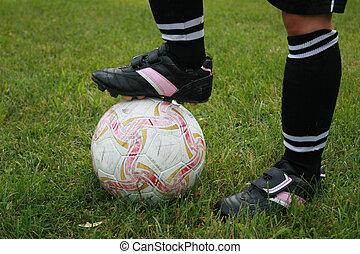 Soccer - soccer ball and players legs.