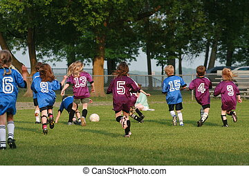 young soccer team - Soccer teams playing in the summer