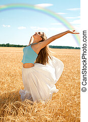 fresh wind and big rainbow - fit girl working out at the...