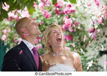 Rose petals - Newly wed couple being showered in rose petals