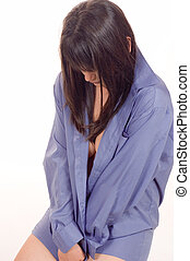 Beauty ashamed girl dressed in blue shirt